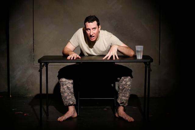 Michael Hogan in KANDAHAR by Neil LaBute, part of the LaBute Theatre Festival at  59E59 Theaters. Photo by Carol Rosegg