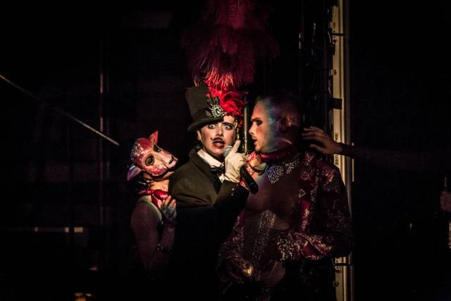 Charlotte Bydwell (center) as Zeus/Fifi and Jakob Karr as Paris. Photo credit: Mark Shelby Perry