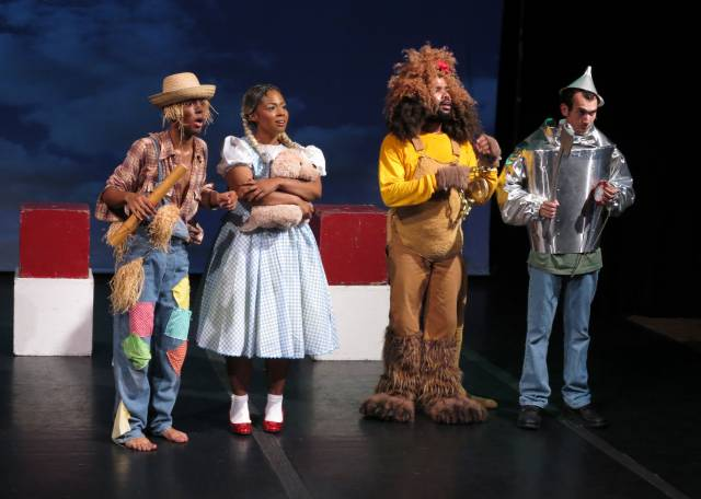 "Harlem Repertory Theatre presents ""The Wizard of Oz"" at Tato Laviera Theatre of Harlem Prep Elementary School, 240 East 123rd Street (at 3rd Ave.), Manhattan.   L-R: Dexter Thomas-Payne (Lion), Derrick Montalvado (Scarecrow), Ben Harburg (Tin Man), Taylor-Rey Rivera (Dorothy).  Photo by Jonathan Slaff."