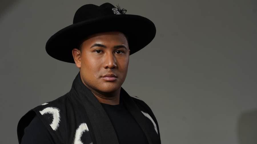 Photo of Roger Q Mason in black hat