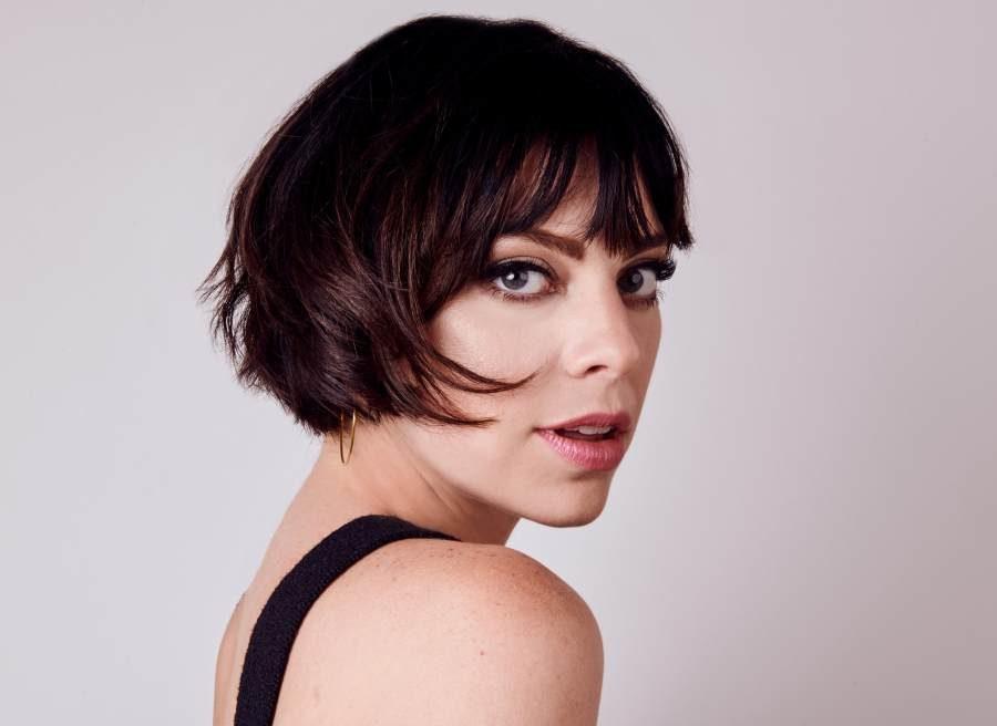 Headshot of Krysta Rodriguez